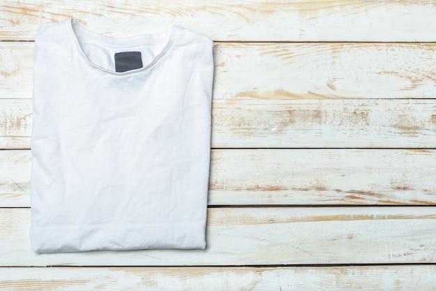 Shirt over wood background Premium Photo
