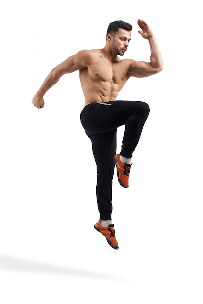 Shirtless bodybuilder jumping in place. Free Photo