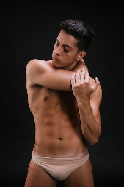 Shirtless male stretching neck and arm Free Photo