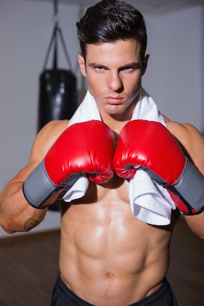 Shirtless muscular boxer in defensive stance Photo   Premium