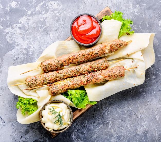 Shish kebab or lyulya-kebab Premium Photo