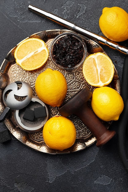 Shisha parts, tobacco and lemons close up photo Premium Photo