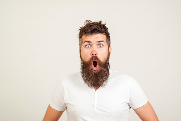 Shocked bearded man with white shirt Premium Photo