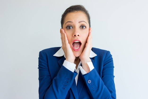Shocked business woman extremely surprised. Free Photo