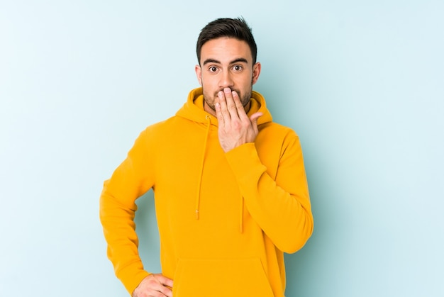 Shocked, covering mouth with hands, anxious to discover something new. Premium Photo