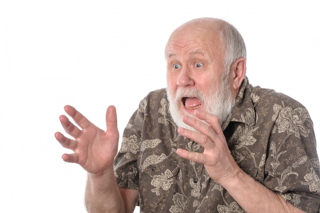 Shocked senior man with grimace of fear. Premium Photo