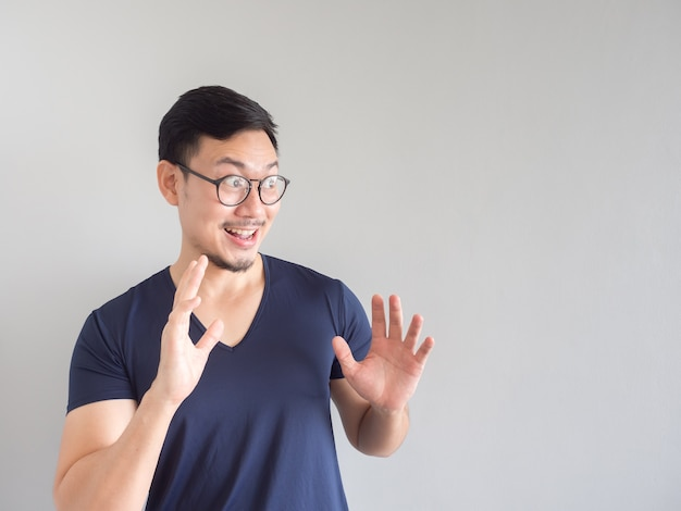 43d9c594a4f Shocked and surprised asian man with eyeglasses and beard looking on  copyspace. Premium Photo