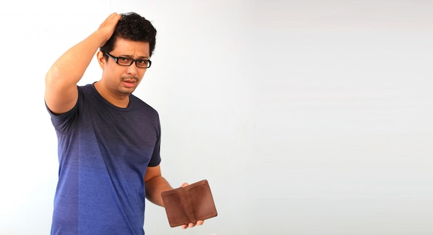 Shocked, surprised speechless man holding an empty wallet on white. Premium Photo