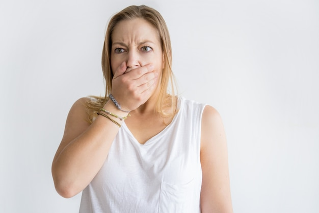 Shocked woman covering mouth with hand Free Photo