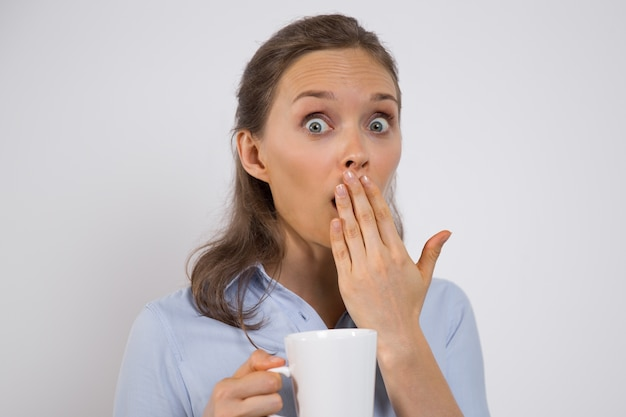 Shocked woman finding out secret of company Free Photo