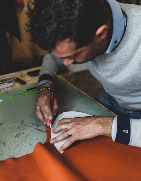 Shoe designer working with leather. Premium Photo
