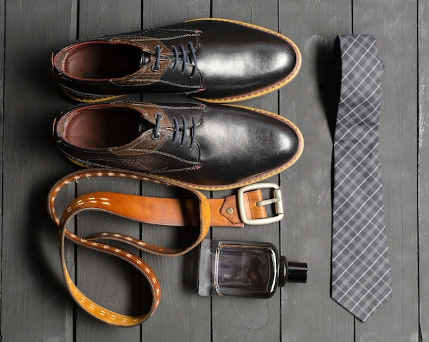 Shoes and accessories for men lay on the wood floor Premium Photo