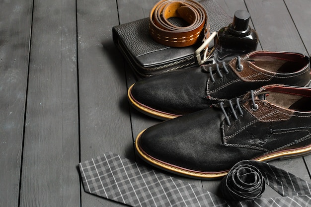 Shoes and accessories for men lay on the wooden floor Premium Photo