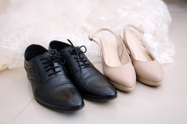 Shoes of bride and groom preparation for wedding concept. Premium Photo