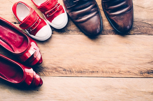 Shoes, three pairs of dad, mom, son - the family concept Premium Photo