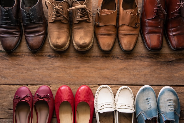 Shoes with men and women various styles on a wooden floor - lifestyles. Premium Photo