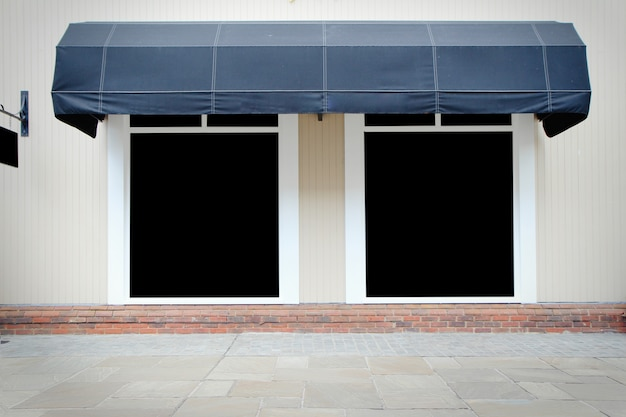 Shopfront vintage store front with canvas awnings and blank display Premium Photo