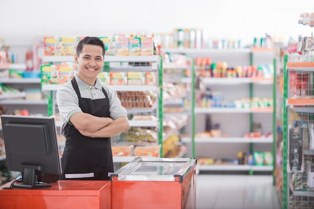 Shopkeeper in a grocery store Premium Photo