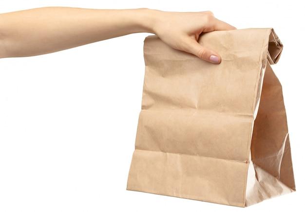 Shopping bag. female hand holding shopping bag on white Premium Photo
