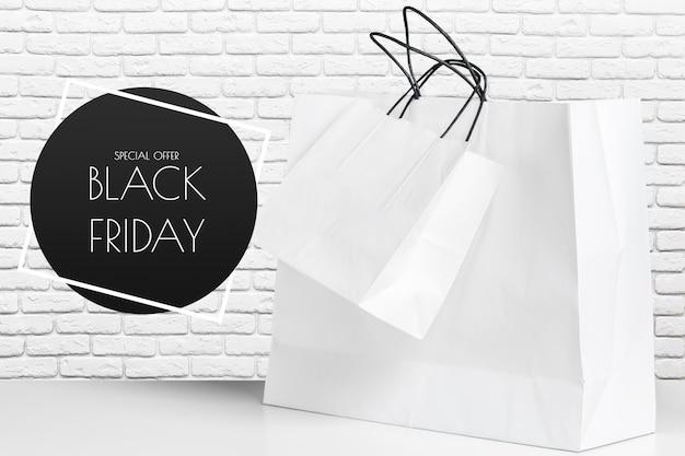 Shopping bag of presents on white table. Premium Photo