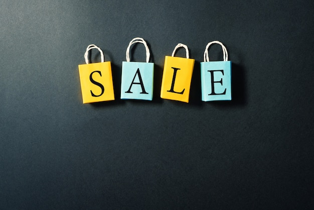 Shopping bag with sale text Premium Photo
