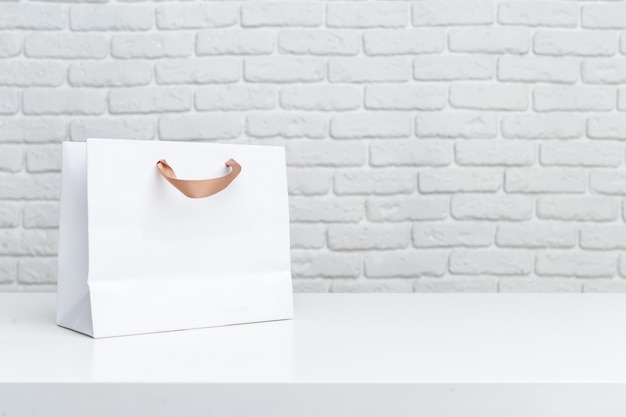 Shopping bags on table Premium Photo