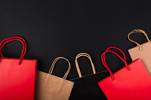 Shopping bags in various colors with copy-space Free Photo
