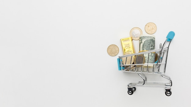 Shopping cart filled with money copy space Free Photo