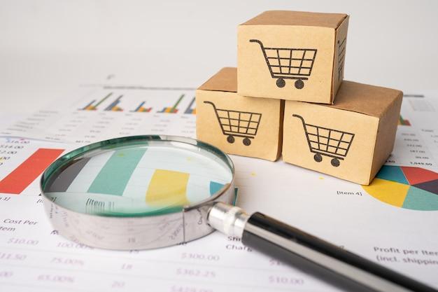 グラフ上の虫眼鏡付きボックスのショッピングカートのロゴ Premium写真
