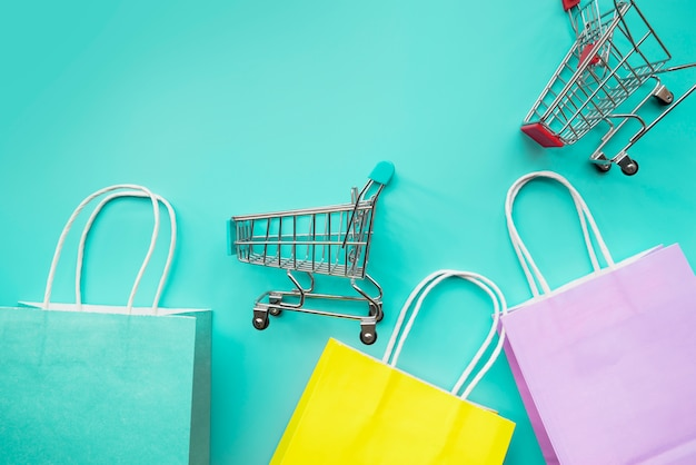 Shopping cart miniatures with paper bags Free Photo
