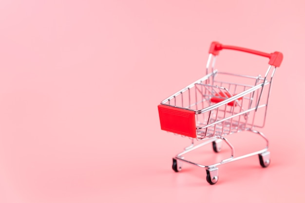 Shopping cart on plain background with copy-space Free Photo