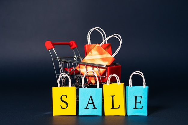 Shopping cart and shopping bag, year-end sale, 11.11 singles day sale concept Premium Photo