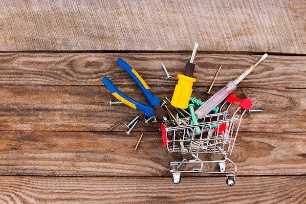 Shopping cart with construction tools. toned image. Premium Photo