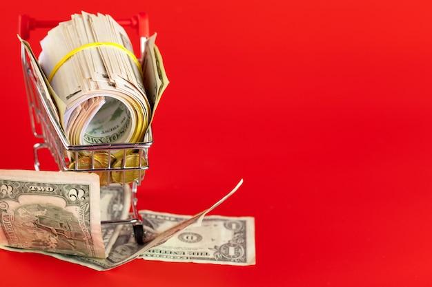 Shopping cart with dollars inside Premium Photo