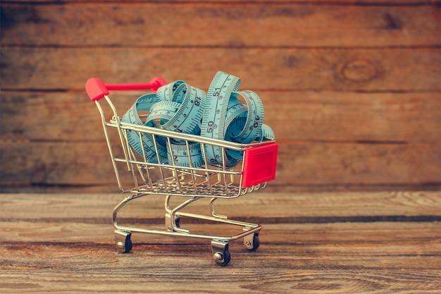Shopping cart with tape line on old wood Premium Photo
