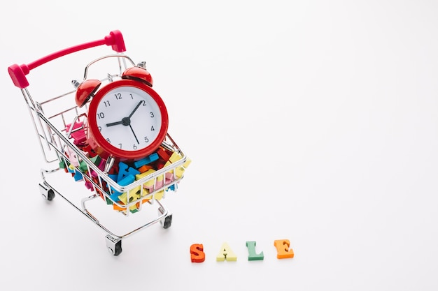 Shopping cart with time management concept Free Photo