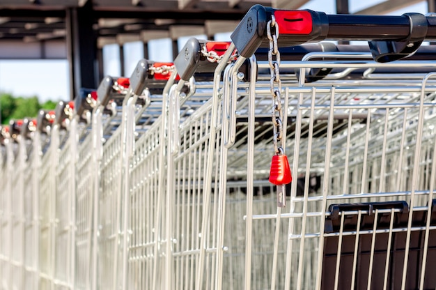 Shopping carts in the store, assembled in a row in the parking lot. close-up. Premium Photo