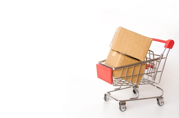 Shopping concept : cartons or paper boxes in red shopping cart on white background. online Premium Photo