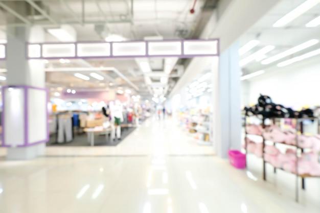 쇼핑몰 초록 Defocused 배경을 흐리게. 사업 개념. 프리미엄 사진