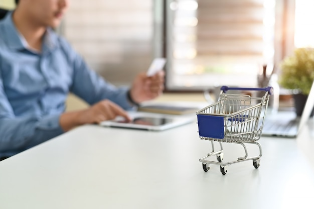 Shopping online concept, boxes in a trolley online shopping is a form of electronic commerce . Premium Photo