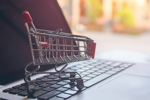 Shopping online concept empty shopping cart on a laptop keyboard Premium Photo