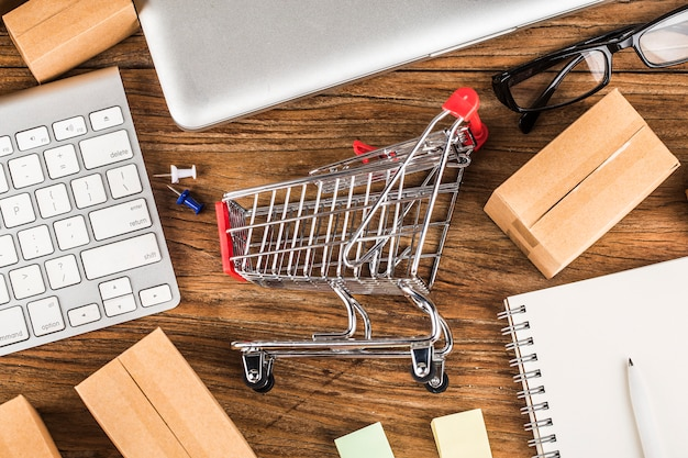Shopping online at home concept. cartons in a shopping cart on a laptop keyboard. Premium Photo