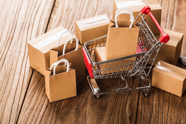 Shopping online at home concept.cartons in a shopping cart on a laptop keyboard Premium Photo