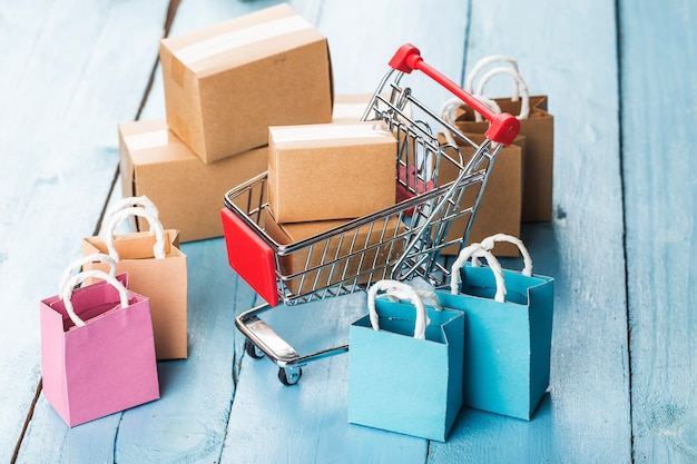 Shopping online at home concept.online shopping is a form of electronic commerce that allows consumers to directly buy goods from a seller over internet Premium Photo