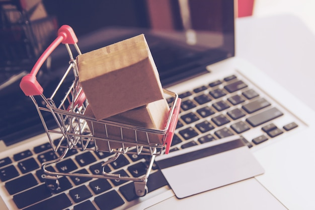 Shopping online shopping service on the online web. with payment by credit card on laptop Premium Photo