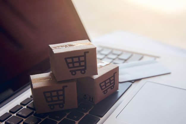 Shopping online. shopping service on the online web. with payment by credit card on laptop Premium Photo