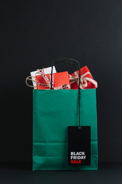 Shopping packet with present boxes with sale tag Free Photo