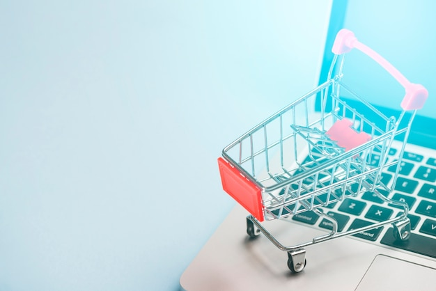Shopping trolley on laptop Free Photo