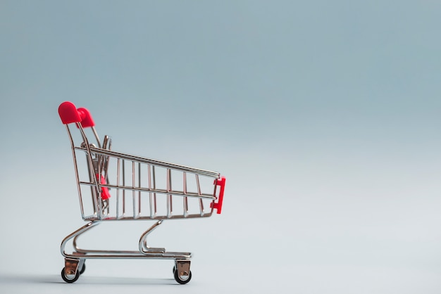 Shopping trolley with red handle Free Photo