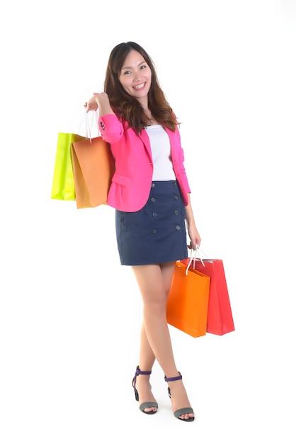 Shopping young asian women holding shopping bags. Premium Photo